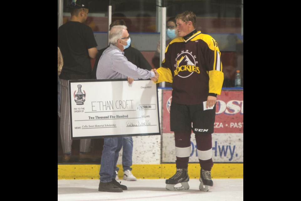Cochrane Rockie's U18 hockey player Ethan Croft receives the Colby Sweet Memorial Scholarship at the Tuesday (June 29) at the Cochrane Arena. (Chelsea Kemp/The Cochrane Eagle)