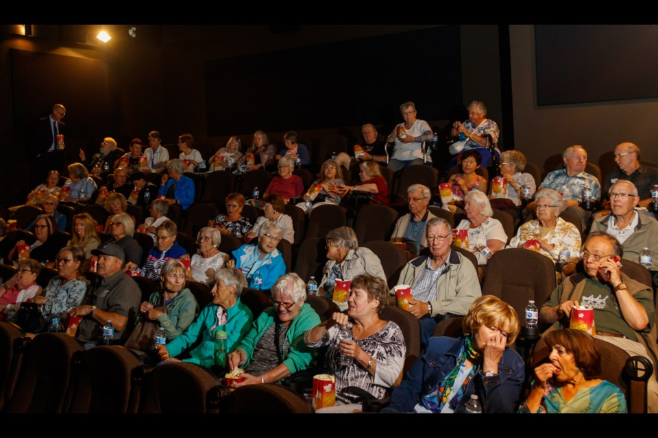 Guests arrive to watch the 1981 classic On Golden Pond at the Seniors Free Movie Day at the Cochrane Movie House on Monday (July 19). (Chelsea Kemp/The Cochrane Eagle)