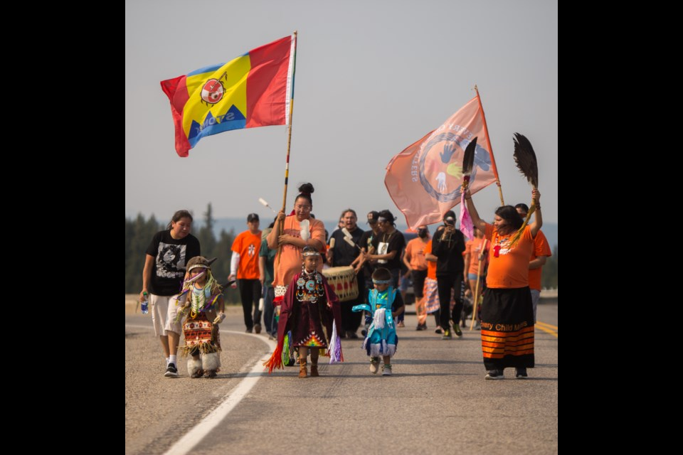Shayna Tapotat arrives in Stoney Nakoda First Nation on Tuesday (July 26). Taypot is from the Kahkewistahaw First Nation, located 165km east of Regina, in Saskatchewan. She is walking to Kamloops in honour of the 215 remains of children found at a former residential school. (Chelsea Kemp/The Cochrane Eagle)