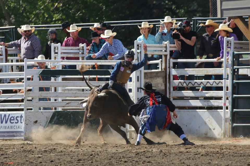 Cochrane's own Beau Gardner goes for a ride on the bull Blowing Smoke. (Tyler Klinkhammer/The Cochrane Eagle)