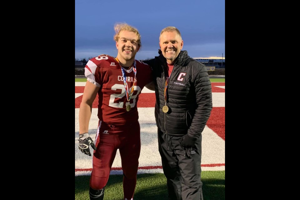 Chandler Ball poses for a photo with head coach Robbie McNabb. Photo submitted.