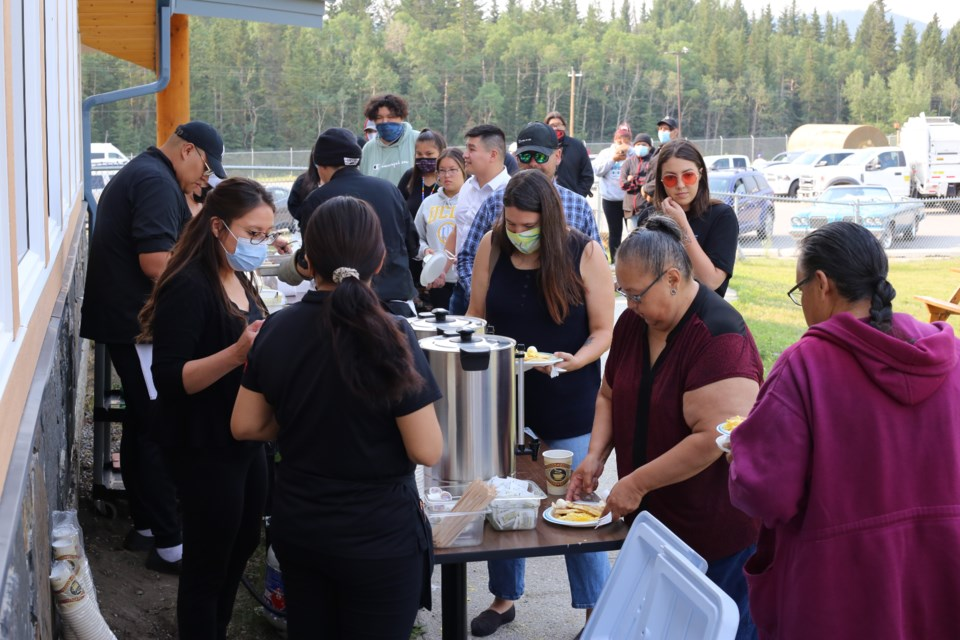 A line of visitors stretches towards the parking lot of Smitty's on the Chiniki First Nation on the morning on Wednesday (July 14). Hundreds of residents came out for the complimentary breakfast and the lineup remained long for several hours. (Tyler Klinkhammer/The Cochrane Eagle)