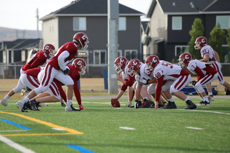The Cochrane Cobras face off on the turf at Bow Valley High School during a competitive scrimmage on Thursday (Oct. 8). (Tyler Klinkhammer/The Cochrane Eagle)