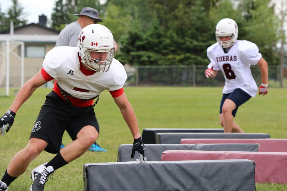 Cobras players work on agility drills at the training camp on Wednesday (June 23). (Tyler Klinkhammer/The Cochrane Eagle)