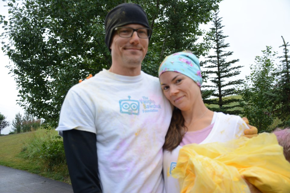 Greg and Jamie Sawchuk at the third annual one-kilometre Vaughn Memorial Colour Run Sept. 1. The third annual event honours their son, Vaughn Sawchuk – who died at just 28 days old from a heart condition – and raised $7,700 for the pediatric cardiac intensive care unit at Stollery Children's Hospital.  Photo by Chrissy Da Silva/Great West Newspapers