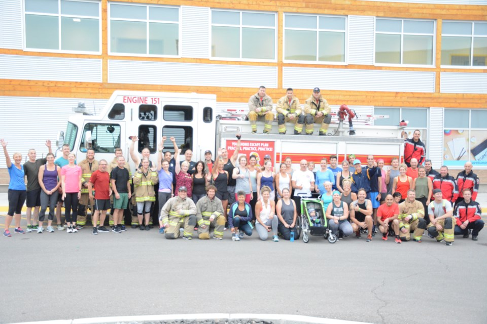 The workout crew huddles for a group photo before sweating it out.