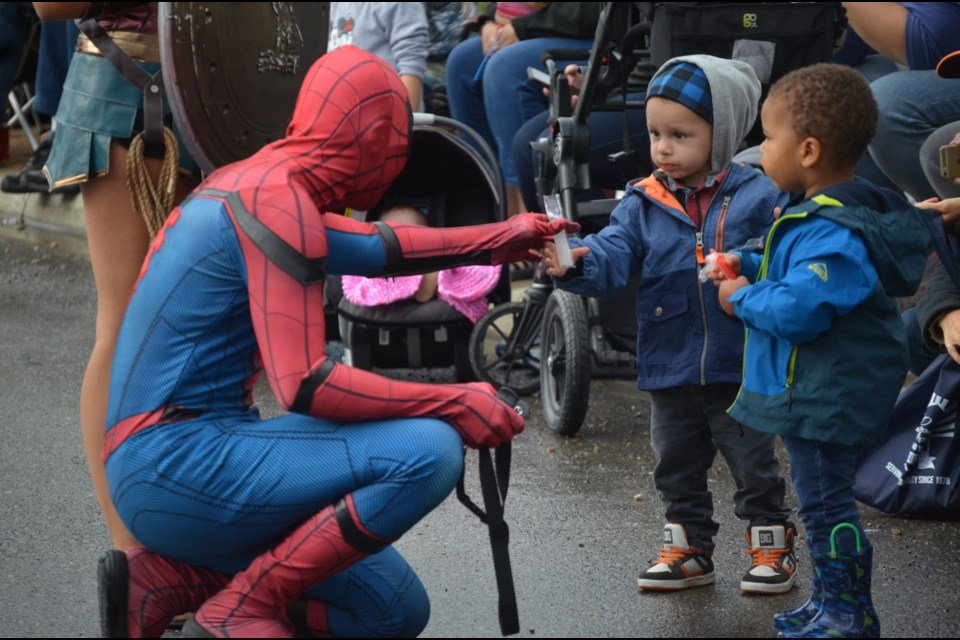Spiderman meets with Mataio Marciniak, 2,  and Hendrix Mulli on the Cochrane Labour Day Parade route Sept. 2.  Photo by Chris Puglia/Great West Newspapers