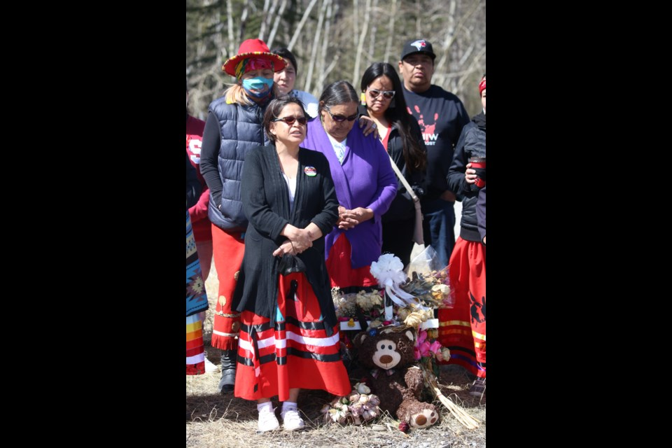 Heather Poucette, the mother of Keesha Crawler, stands with the family and friends of her late daughter. The women in attendance wore red dresses, which has become a symbol to honor and commemorate missing and murdered Indigenous women. (Tyler Klinkhammer/The Cochrane Eagle)