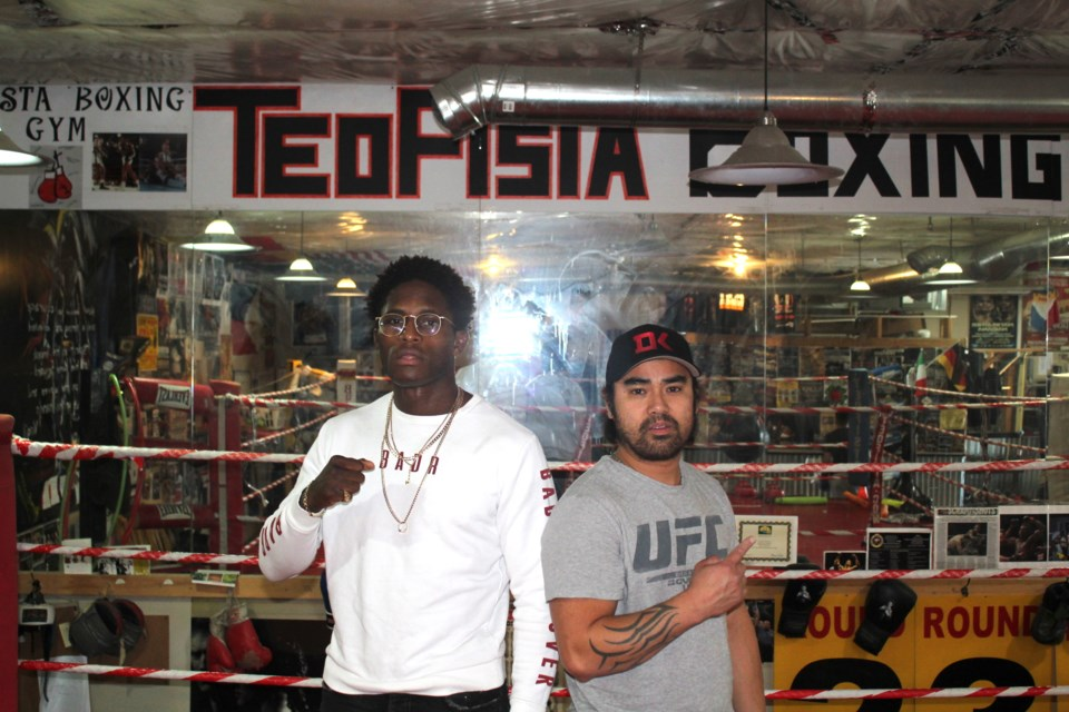 UFC fighter Hakeem Dawodu (left) and his trainer Eric De Guzman (right) are hard at work training for UFC 244 where Dawodu will fight American Julio Arce.   Photo credits to Troy Durrell