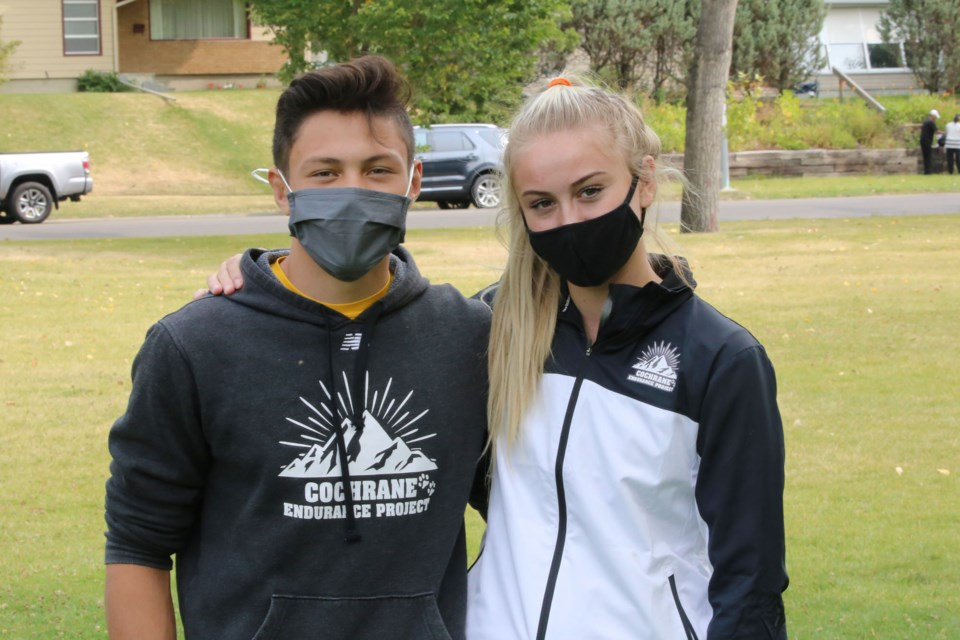 Nicholas Hooper (left) and Holly Moores (right) have both been participating in the Cochrane Endurance Program since its inception two year ago. Nicholas finished the five-kilometre event on Saturday (Sept. 12) with a time of 18:26, while Holly finished in 20:08. (Tyler Klinkhammer/The Cochrane Eagle).