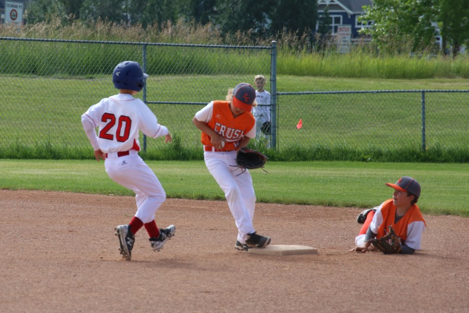 Shortstop Riley Boychuk made a diving catch and toss to second baseman, George Evans, scoring an out for the Crush. (Tyler Klinkhammer/The Cochrane Eagle)