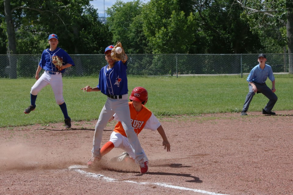Braeden Bohach-Murray slid into third just inches ahead of the ball in the bottom of the second innning.