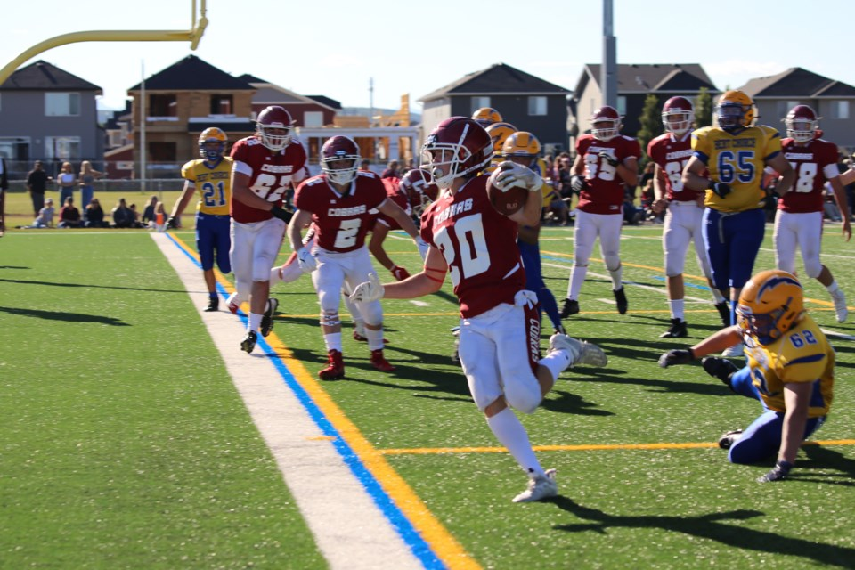 Ethan Clazie finds a clear route to the endzone on Friday (Sept. 3) at the field behind Bow Valley High School. (Tyler Klinkhammer/The Cochrane Eagle)