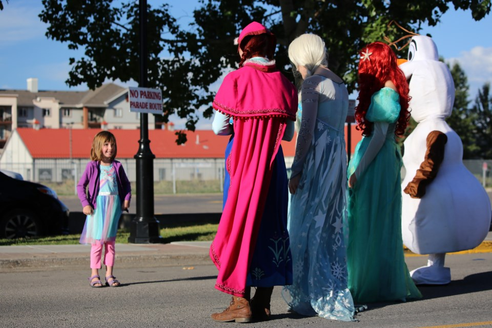 Seven-year-old Stella met a few of her favourite Disney characters on Monday (Sept. 6) morning. (Tyler Klinkhammer/The Cochrane Eagle)