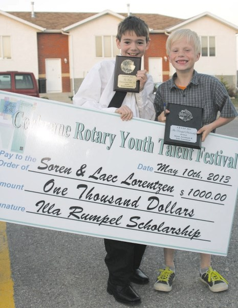 Soren and Laec Lorentzen receive a $1,000 scholarship from the Rotary Youth Talent Festival in 2013.