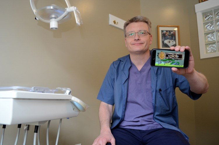 Cochrane dentist Dwayne Hinz has created an application (app) for a game based on Cecil the Lion, the wild lion shot in Zimbabwe last summer by a U.S. dentist.