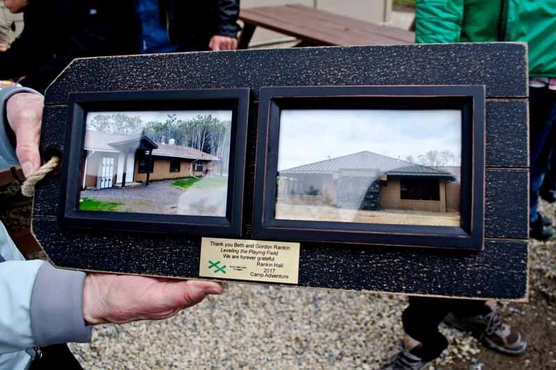 Beth Rankin, donor of the new Rankin Hall at the Boys and Girls Club of Calgary Camp Adventure shows off her gift at the unveiling ceremony on May 26.