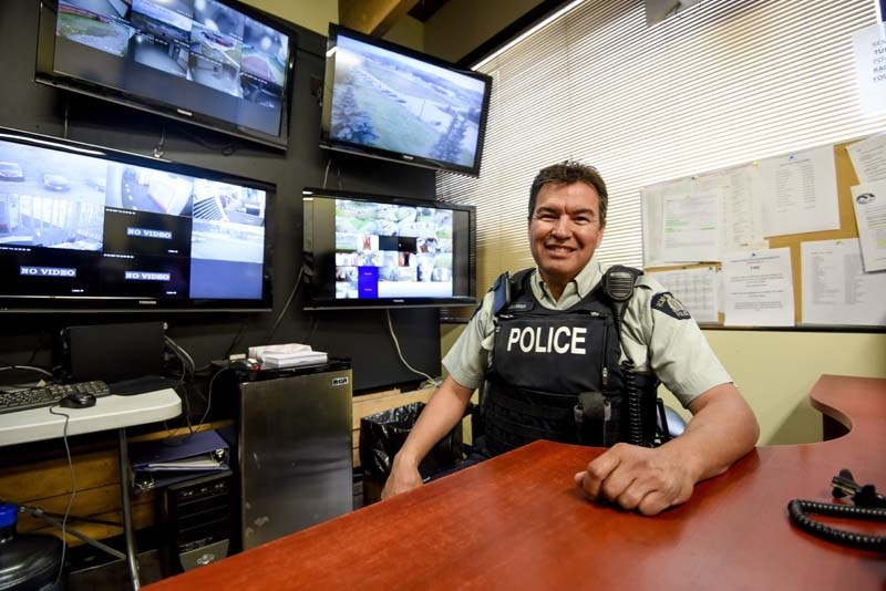 RCMP's Cst. Don Vanderrick sits at his office desk in Morley on Tuesday, July 11, 2017.