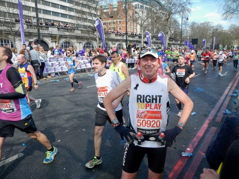 Marathon participants approach the London Bridge April 2.
