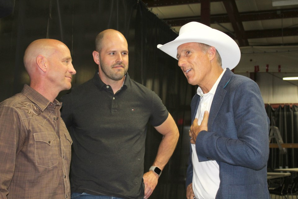 Maxime Bernier, leader of the People's Party of Canada, speaks with Mayor Jeff Genung and Coun. Pat Wilson at the Lions Event Centre on July 13.