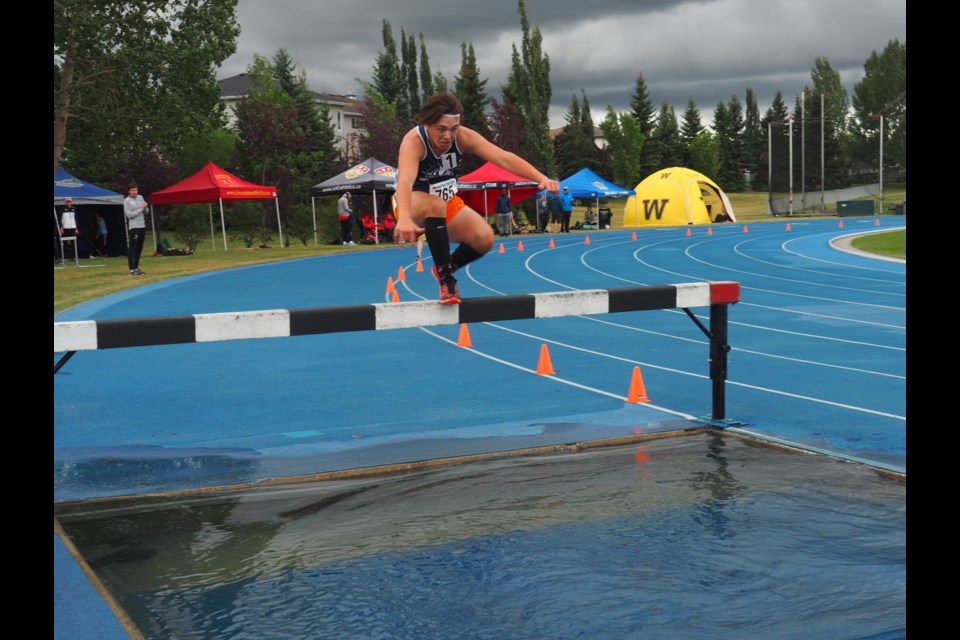 The Endurance Project's Brendan Maguire jumps over a pool of water in the men's steeplechase. Photo submitted.