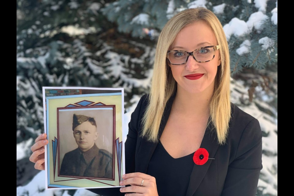 Banff-Kananaskis MLA Miranda Rosin holds a photo of her great uncle Bill Wildeman. Submitted Photo
