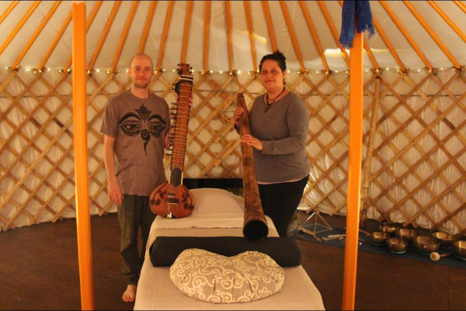 Jay Robinson and Justine Sanderson use the vibrations of music to offer relaxation and healing in their yurt. Maddie Johnson for CollingwoodToday