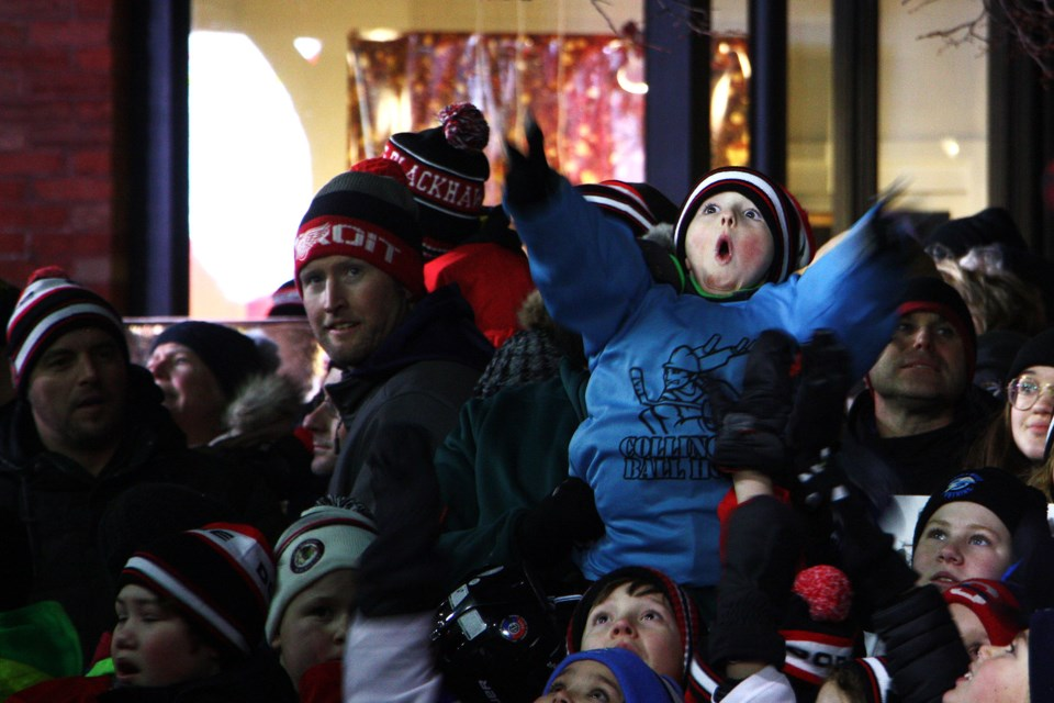 A young fan gets excited as the camera jib swings overhead at Hometown Hockey in Collingwod on Sunday night. Erika Engel/CollingwoodToday
