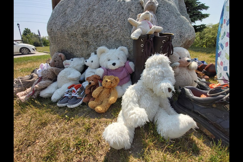 A growing memorial of teddy bears, shoes and flowers sits west of town hall in Thornbury.