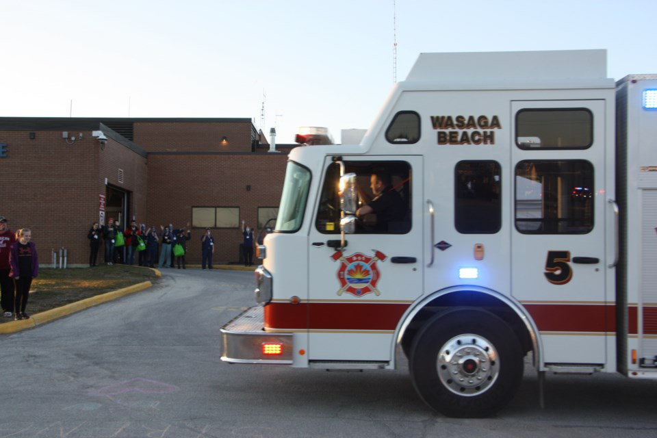 Fire trucks from Collingwood, Clearview, Wasaga Beach, and The Blue Mountains paraded past the hospital with sirens blaring on April 2 at 7:30 p.m. Erika Engel/CollingwoodToday