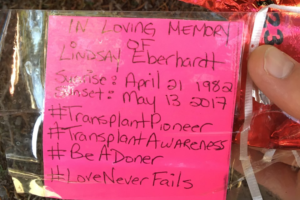 These notes were attached to 50 red heart-shaped balloons released from Sunset Point on April 21 in memory of Lindsay Eberhardt. Jordan Sykes Photo