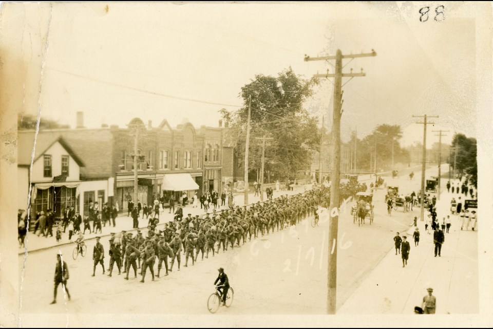 Hurontario Street between Fourth Street East and Ontario Street in 1916 during a military parade. Huron Institute 88; Collingwood Museum Collection X2009.4.1