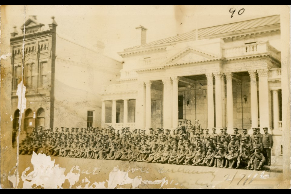 This photo of the 157th Battalion shows the soldiers fixing their gaze on a point across the street, which led museum staff to search for the reason. Photo contributed by the Collingwood Museum. Huron Institute 90; Collingwood Museum Collection X2009.48.1