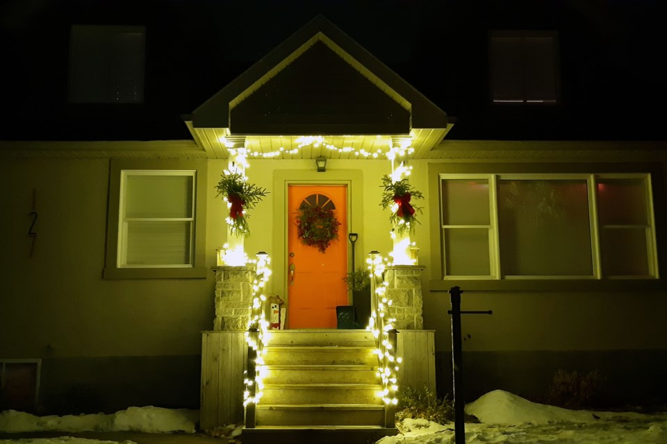 Red bows, white lights and green garland - this classic look never ages. You'll find lots of homes like this in Collingwood, but this one was in the Central Park area. Erika Engel/CollingwoodToday