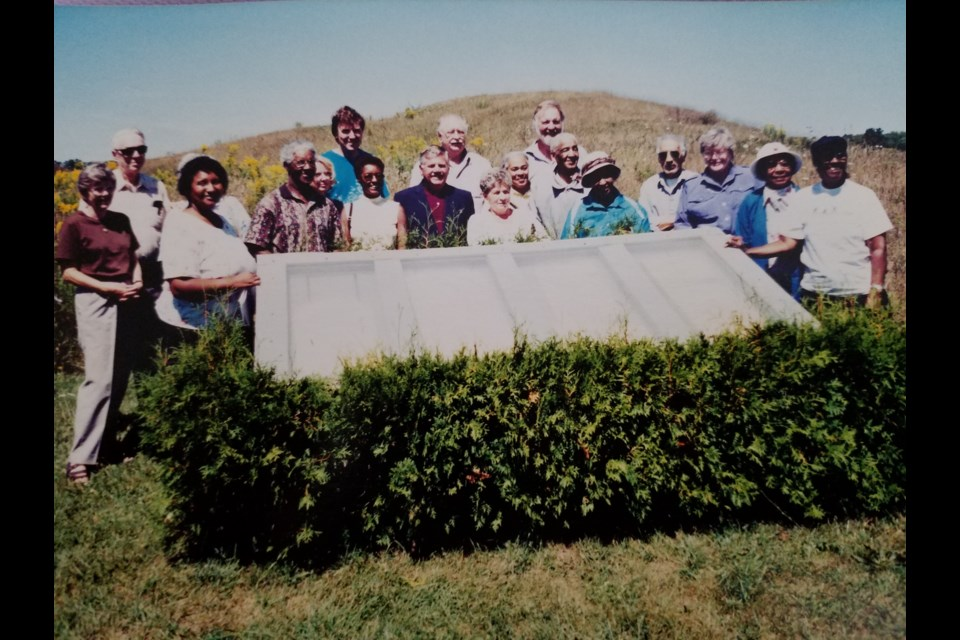 The original Old Durham Road Cemetery Committee standing with the first memorial commemorated in the 1990s.