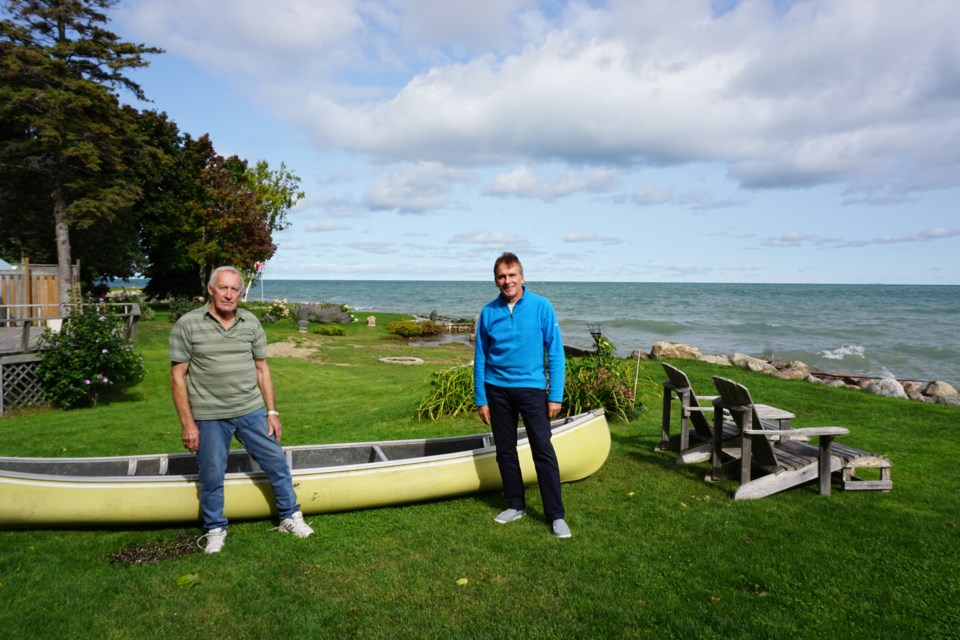 Bob Woodcock and Robert Turner have been installing the Canadian flag off the shore of Northwinds Beach for several years. Jennifer Golletz/CollingwoodToday