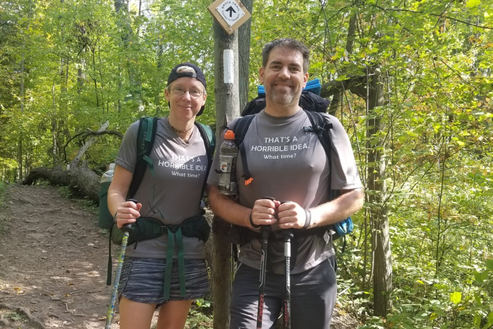 Tyler Gibson with Kelly Doner, a friend who joined him for a portion of his Bruce Trail hike. Both are wearing t-shirts they had made for the occasion. The shirts say