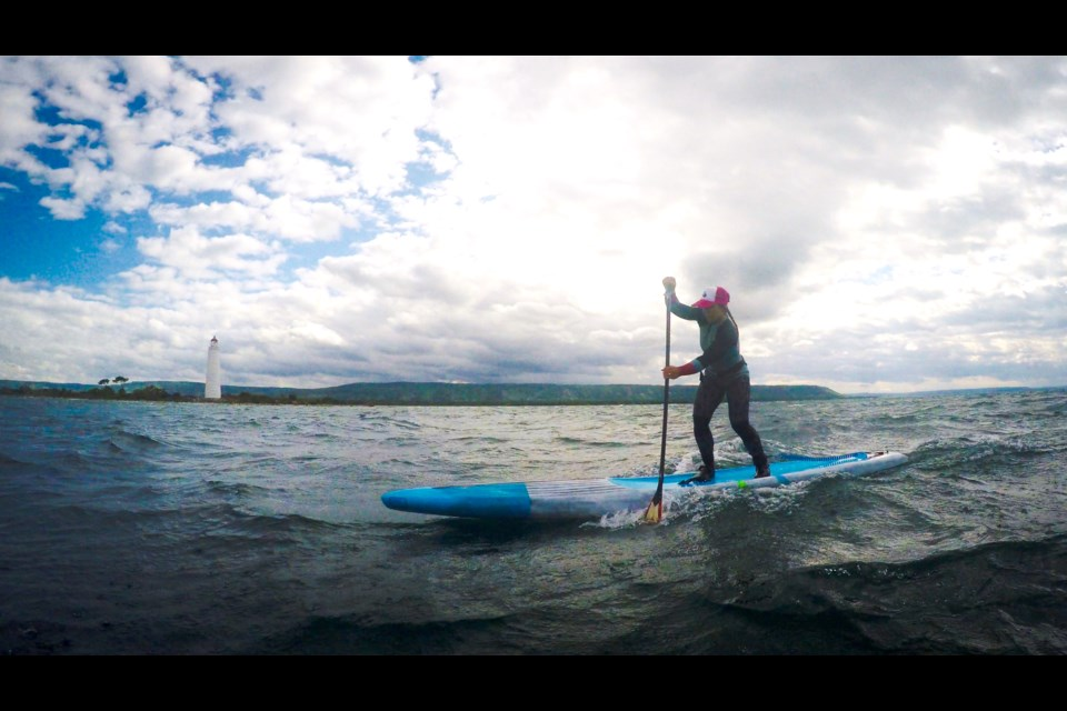 Ariel Amaral paddling in the Collingwood Harbour. Maddie Johnson for CollingwoodToday