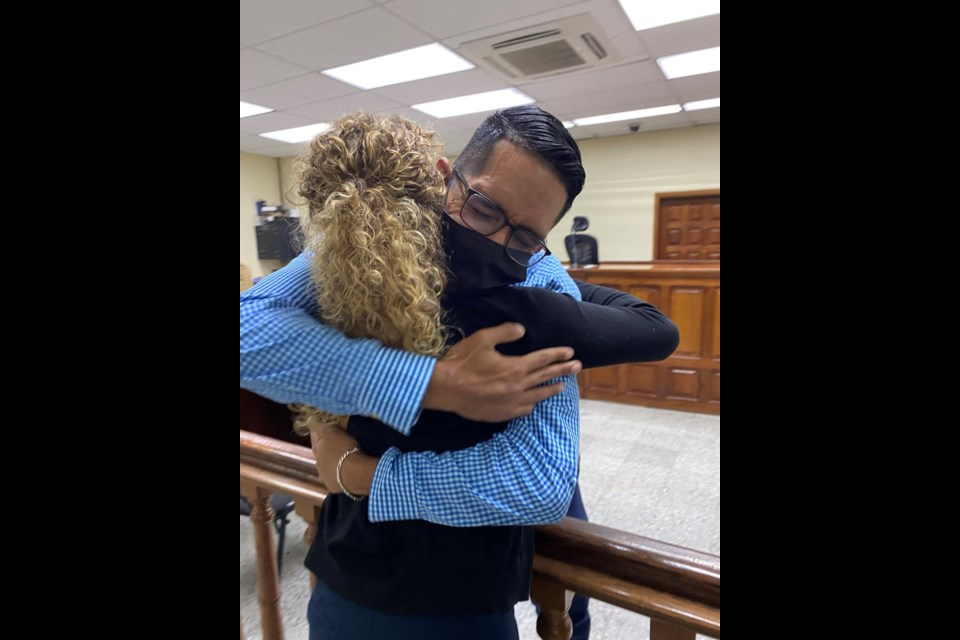 Karen Spring embraces her friend Raul Alvares after a Honduran court declared he was innocent of the charges laid against him that kept him in an inhumane prison for 19 months. Karen's husband was also cleared of charges after the same imprisonment.