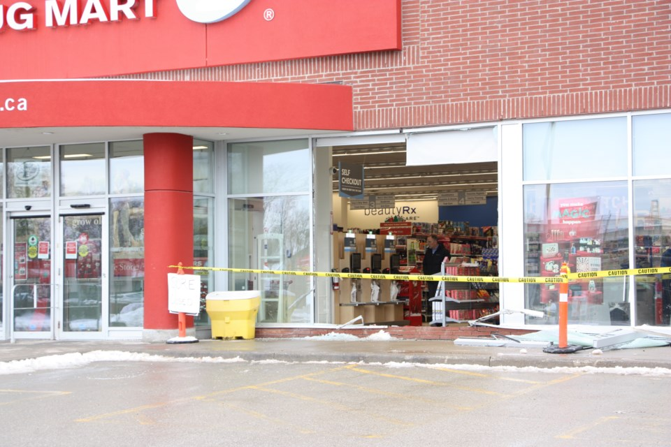 Mark Matthews, owner of Shoppers Drug Mart in Collingwood surveys some of the damage to the check out area. Nobody was hurt despite the car coming through the window at the cash registers. Erika Engel/CollingwoodToday