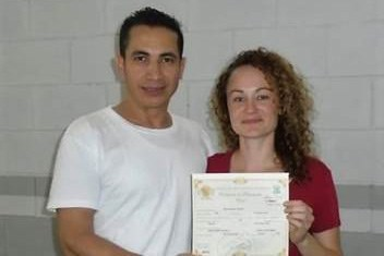 Edwin Espinal and Karen Spring on their wedding day. They are holding their marriage certificate. The ceremony took place at the chapel at La Tolva prison, a military-run maximum security prison in Honduras. Contributed photo