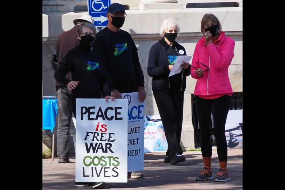 Pivot2Peace members were outside the Collingwood federal building on Hurontario Street yesterday to mark World Peace Day. Contributed photo