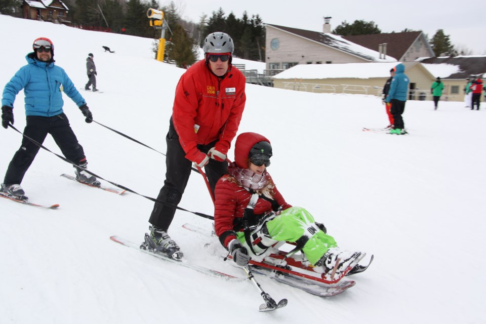 Volunteers from CADS Ontario and Track 3 helped those with spinal cord injuries try adaptive skiing at Craigleith Ski Club yesterday. Erika Engel/CollingwoodToday