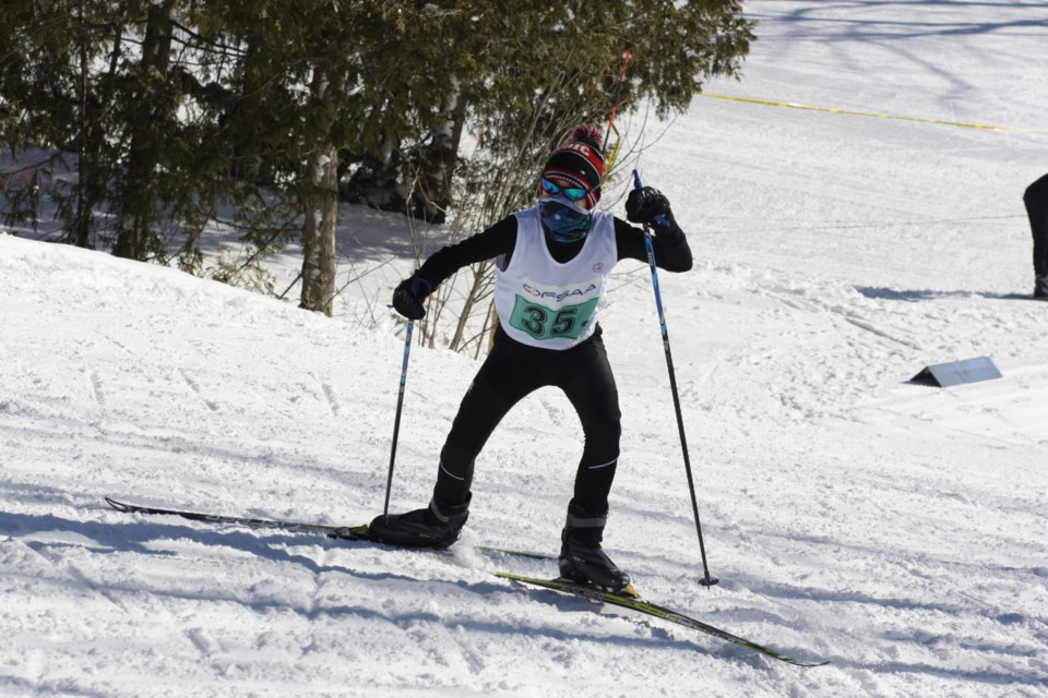 A junior boy's relay team skier from St. Mary's DCVI pushes up a hill. Erika Engel/CollingwoodToday