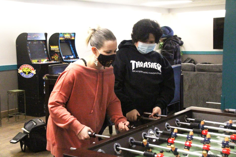 Tara Ray hits up some foosball with local youth.