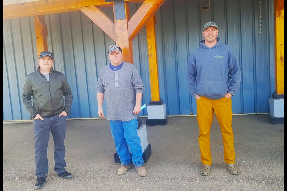 Dawson Creek Sportsman's Club President Andy Waddell, centre, is with raffle grand prize winner Alex Pfeifer (left) and second place winner Shane Burgess (right). Clint Regnier, who won third, is not picture.