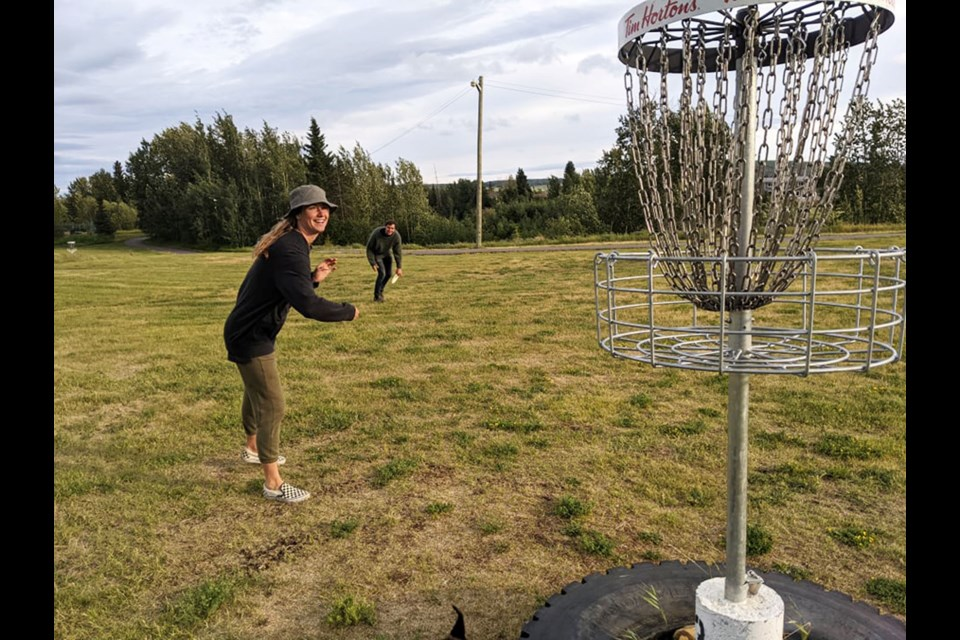Kait Whiteley and Cameron Tennent, with furry friend Hob, enjoyed a windy round of disc golf at the Dawson Creek course, July 22.
