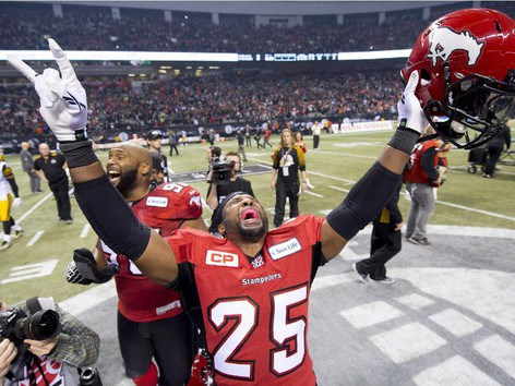 Calgary Stampeders defensive back Keon Raymond celebrates his teams win against the Hamilton Tiger-Cats during the 102nd Grey Cup in Vancouver, B.C. Sunday, Nov. 30, 2014.