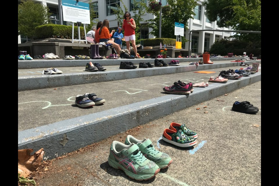 A memorial of little shoes to honour the 215 First Nations children whose remains were found buried at the former Kamloops residential school was established outside Delta Municipal Hall.