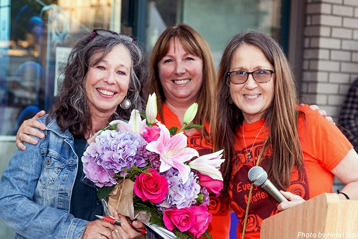 Camille Turner (middle) and Angela Husvik (right) presented Carol Miles a bouquet of flowers during their Fashion Fest 2021 last Friday night at Ladner Village. Miles, who was the event's MC, is retiring as owner of South Delta Heels.
